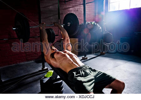A crossfit athlete does tricep exercises. - Stock Photo