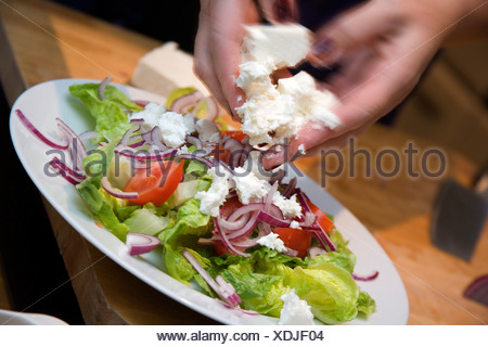 Adding cheese to Mixed Salad / step shot - Stock Photo