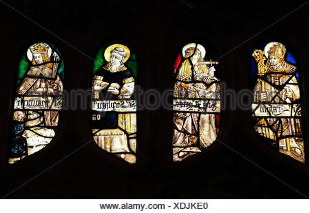Medieval stained glass window, St. Erasmus, Bishop of Formia, St. Agnes, St. Stephen, Sandringham Parish Church, Norfolk England - Stock Photo