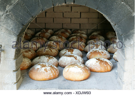 Bread in the baking oven, Bavarian Forest, Bavaria, Germany - Stock Photo