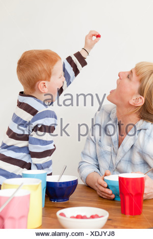 Mother and son playing at table - Stock Photo