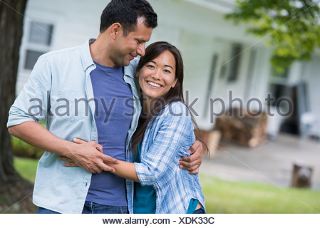 A couple  with arms around each or. - Stock Photo