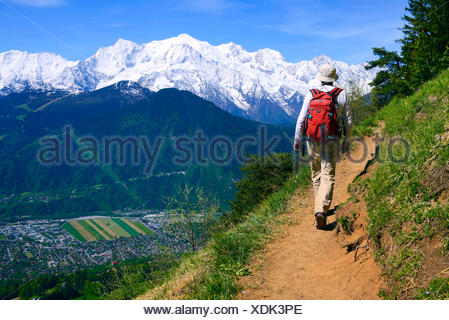 wanderer on mountain trail, the Mont Blanc in background, France, Chamonix - Stock Photo