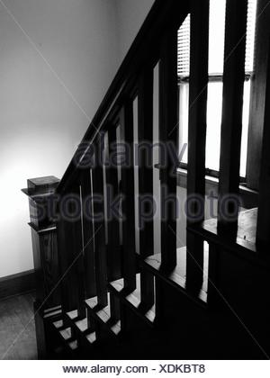 Close-Up Of Cropped Stairs With Railing - Stock Photo