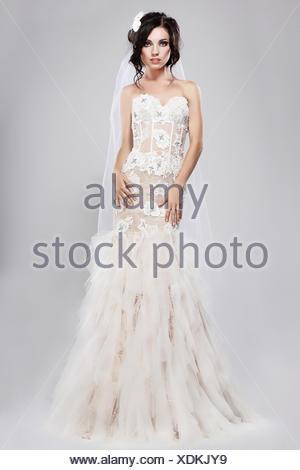 Espousal. Genuine Gorgeous Bride in Long White Bridal Dress. Wedding Style - Stock Photo
