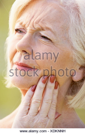 Portrait Of Senior Woman With A Toothache - Stock Photo