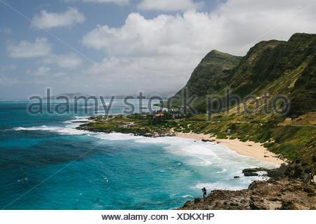 USA, Hawaii, Oahu, Waves breaking on shore near Makapuu Lighthouse - Stock Photo