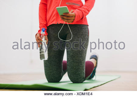 Young woman doing fitness workout - Stock Photo