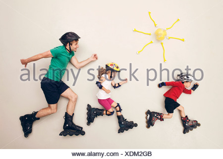 Germany, Artificial scene with family doing inline skating - Stock Photo