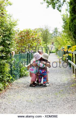 Sweden, Vastra Gotaland, Gothenburg, Mother hugging daughter (2-3) - Stock Photo