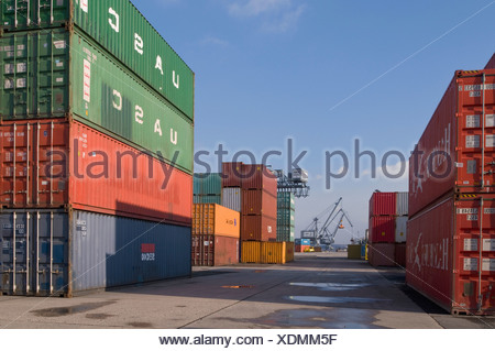 Bonn harbour, overlooking the terminal, cranes in the back, stacked oversea containers in the front, North Rhine-Westphalia, Ge - Stock Photo