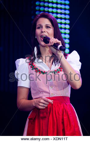 Melanie Oesch from the Swiss folk music and pop group Oesch's die Dritten performing live at the 10th Schlager-Night in the new - Stock Photo