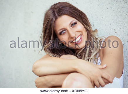 Young, handsome woman, smiling, with long hair and blue eyes, portrait - Stock Photo