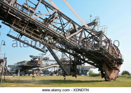 gigantic excavator in the disused lignite opencast - Stock Photo