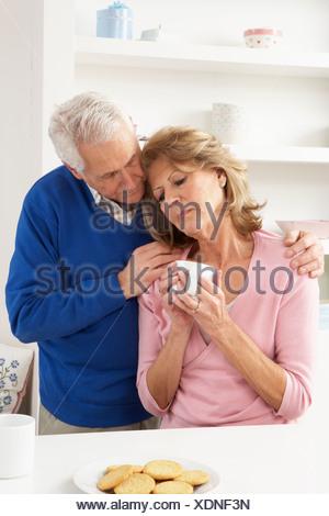 Senior Man Consoling Wife - Stock Photo