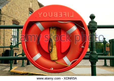Lifebuoy, riverside life saving equipment, England UK, buoy, buoys lifebuoys - Stock Photo