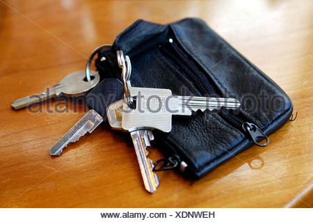 House and car keys laying on a table - Stock Photo