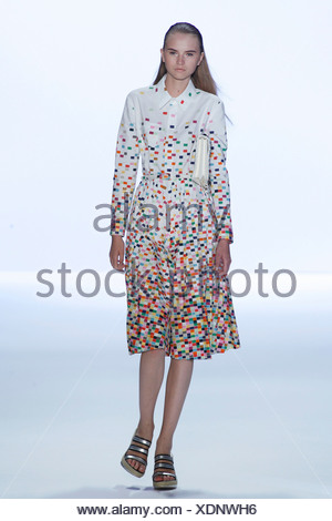 Anne Klein New York Ready to Wear Spring Summer Model long blonde hair wearing white shirt dress multicoloured mosaic pattern - Stock Photo