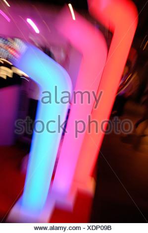 Coloured plastic tubes, light art - Stock Photo