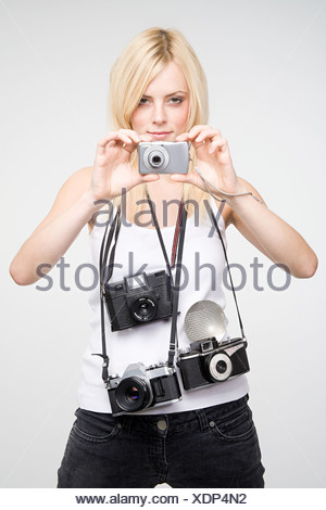 A young woman taking pictures - Stock Photo