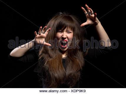 Woman throwing a temper tantrum - Stock Photo