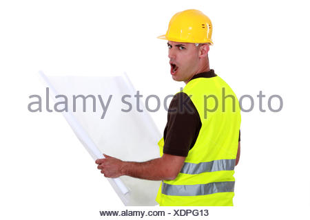 Worker open mouthed in disbelief - Stock Photo