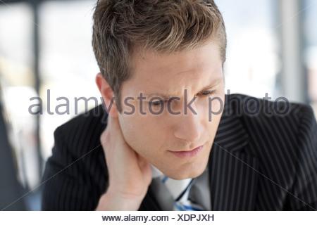 Thoughtful Buisinessman looking at camera - Stock Photo