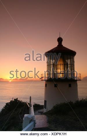 Makapuu pt. lighthouse at sunrise. Located along the southeast coast of oahu. - Stock Photo