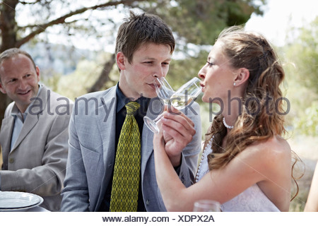 Bride And Groom Drinking Champagne, Croatia, Europe - Stock Photo