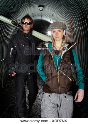 Couple posing in tunnel. - Stock Photo