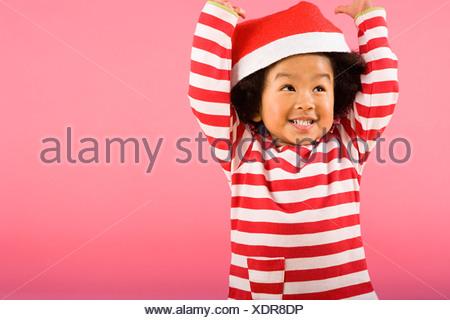 Boy wearing santa hat - Stock Photo