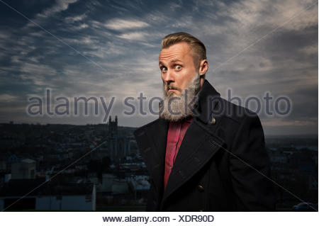 Hipster man making funny face - Stock Photo