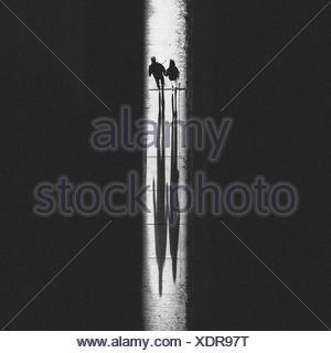 Two People Walking On Glowing Footpath - Stock Photo