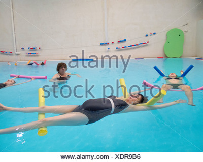 PREGNANT WO. EXERCISING IN WATER - Stock Photo