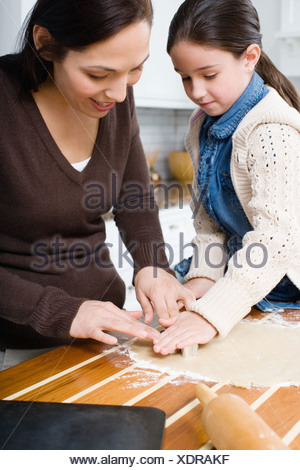 Mother and daughter making cookies - Stock Photo