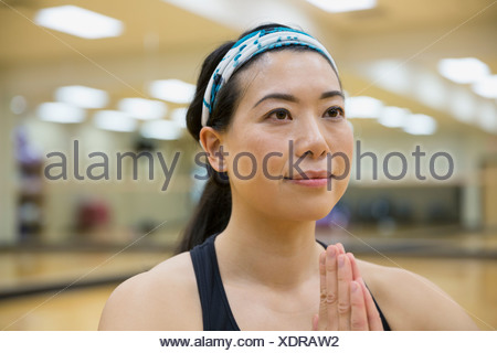 Close up of woman in yoga prayer position - Stock Photo