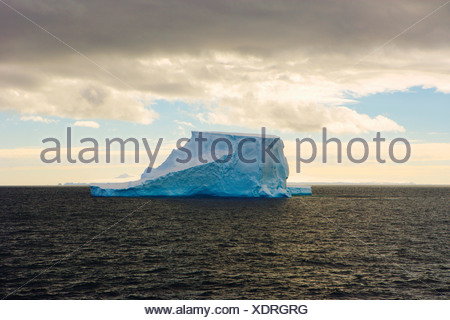 A Lone Iceberg Floats in Gerlache Strait - Stock Photo