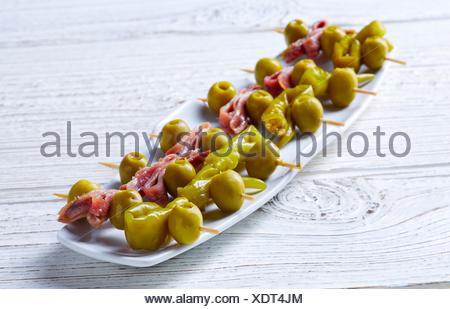 Gilda pinchos with olives and anchovies tapas from Spain. - Stock Photo