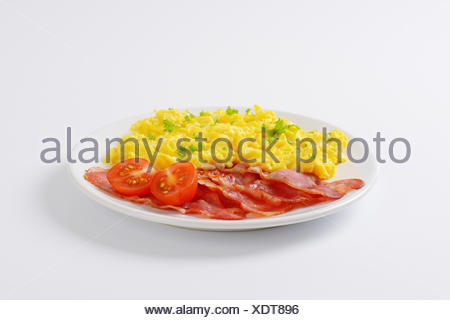 scrambled eggs and pan fried bacon - Stock Photo