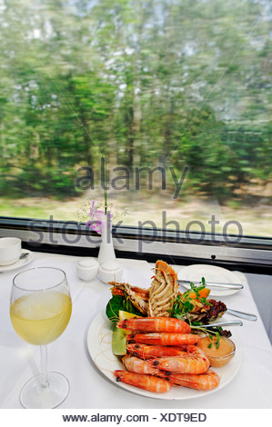 Laid table in the restaurant car of the Sunlander train, Queensland, Australia - Stock Photo