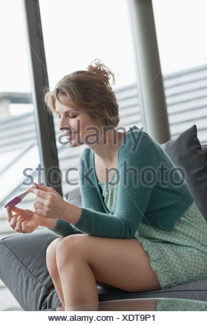 Woman checking her pregnancy - Stock Photo