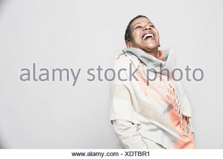 Studio portrait of mature woman laughing - Stock Photo