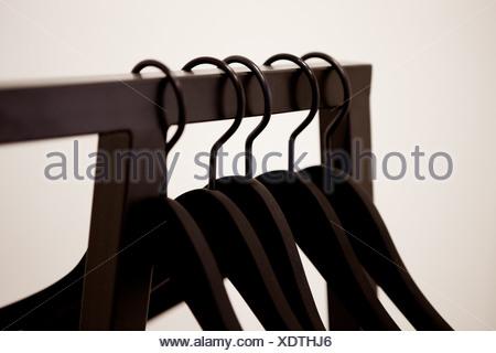 Coat hangers on clothes rack - Stock Photo