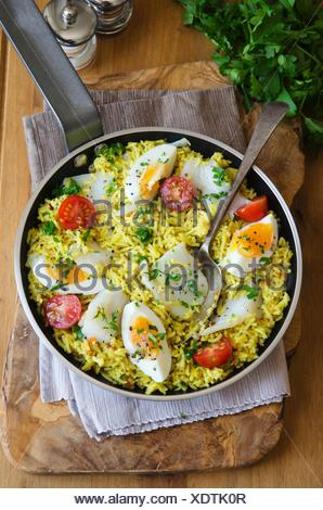 Traditional Kedgeree dish in a pan. - Stock Photo