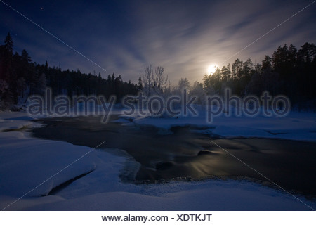 Moonrise on the Oulanka River in Oulanka National Park, Finland. - Stock Photo