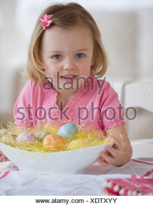 Young girl holding bowl of Easter eggs - Stock Photo