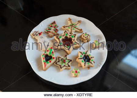 Close-up different shaped cookies in a plate, Munich, Bavaria, Germany - Stock Photo