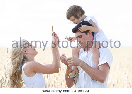 family walking on the field - Stock Photo