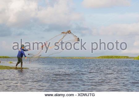 Thailand, Patthalung, Tale Noi, Fisherman, with cast net - Stock Photo