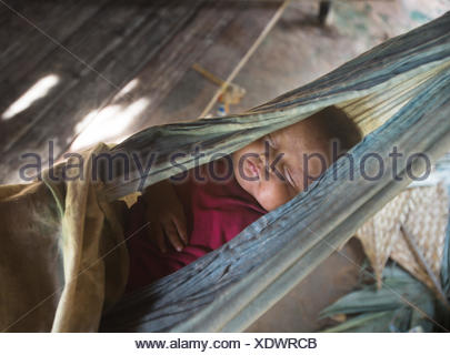 Baby sleeping in a hammock in the Tsimane settlement of Anachere, in the Amazon rainforest. - Stock Photo